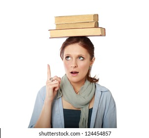 Young caucasian woman (student) with books on her head - looking up , isolated on white background