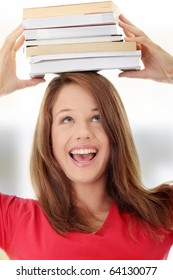 Young caucasian woman (student) with books on her head