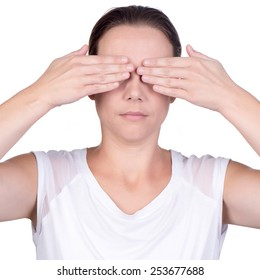 Young caucasian woman using both hands to cover her eyes