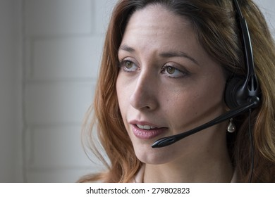 Young caucasian woman using telephone headset