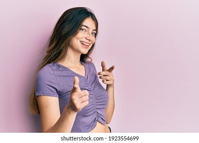 Young caucasian woman wearing casual clothes pointing fingers to camera with happy and funny face. good energy and vibes.