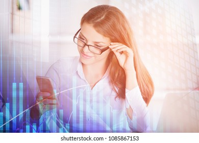 Young caucasian woman working in modern office with technology and forex graph. Financial growth and network concept. Double exposure