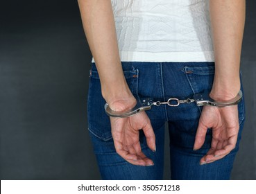 Young caucasian women arrested and with handcuffs
