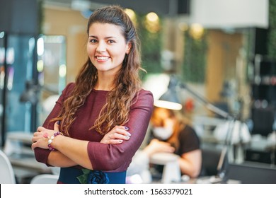 Young charming smiling woman owner of beauty salon nail bar, concept of the own small business