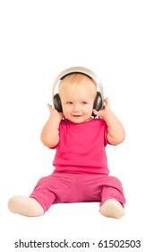 young cheerful baby listening to the music in headphones