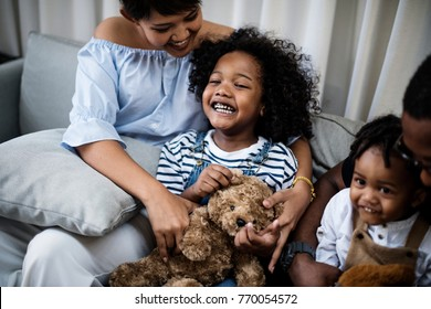 Young cheerful black kid with family
