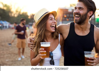 Young and cheerful couple in music festival.