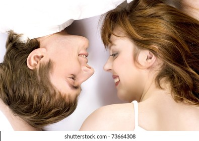 Young cheerful couple touched one another's nose
