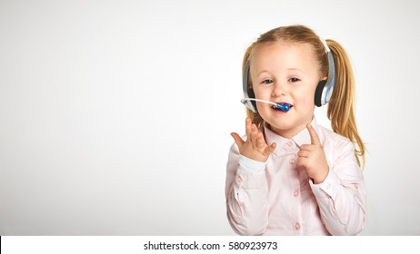 Young cheerful female customer support operator with headset and smiling