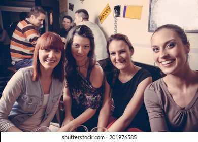 Young Cheerful Female Friends Taking Selfie In Pub