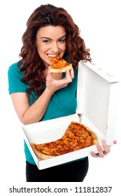 Young cheerful girl enjoying pizza alone. All on white background