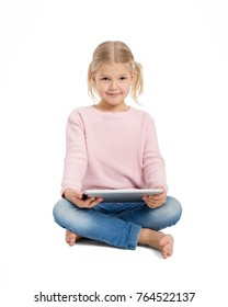 Young cheerful girl sitting with digital tablet isolated on white background