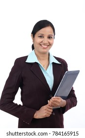 Young cheerful Indian business woman holding laptop