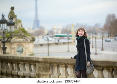 Young cheerful tourist in Paris