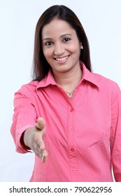Young cheerful woman with shake hand gesture