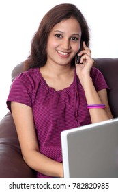 Young cheerful woman talking on cellphone