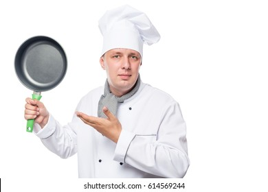 young chef and a frying pan, a portrait on a white background in studio