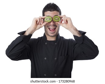 Young chef with kiwi on white background
