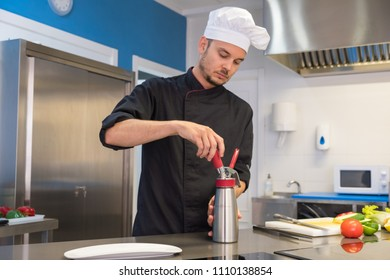 young chef preparing an emulsified sauce