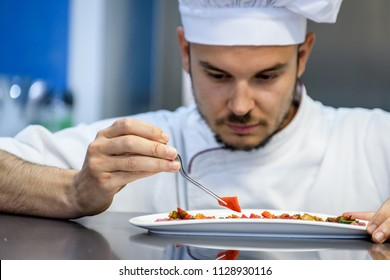 young chef preparing a plate decoration