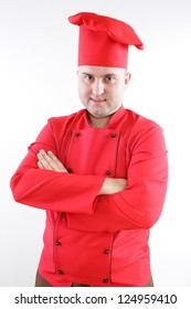 young chef in red on a gray background