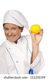 Young chef in the studio with lemon in hand