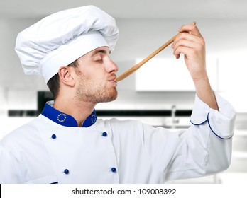 Young chef tasting food