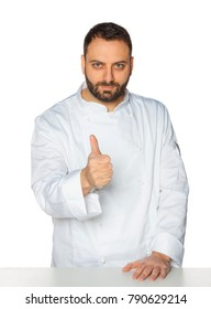 Young chef in white uniform isolated on white background.