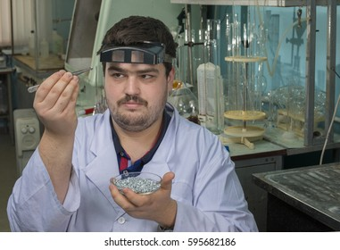 A   young   chemist  conducts  chemical  analyzes  of  production  materials