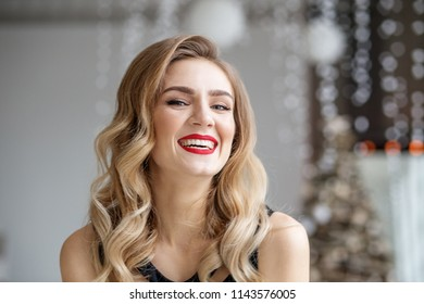 Young chic girl laughs. Red lipstick. Concept of Happy Christmas and New Year, winter, party.