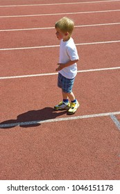 Young child boy on the running track.