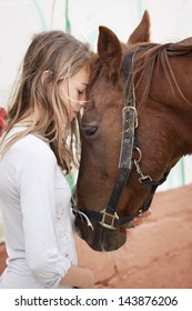 Young child with brown horse