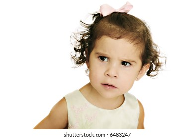 Young Child with a Confused/Angry Expression on an Isolated white background