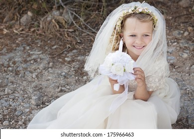 A young child doing her catholic first holy communion