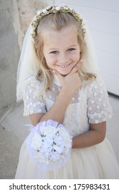 A young child doing her first holy communion