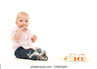 A young child eating and making a mess.