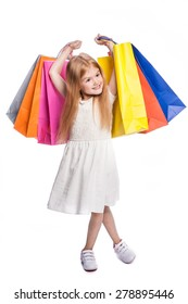 Young child excited with shopping bags.