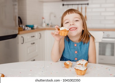Young Child The girl smiles, rejoices at the cake, offers it. Concept friendship, share, treat.