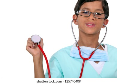 Young child holding a stethoscope