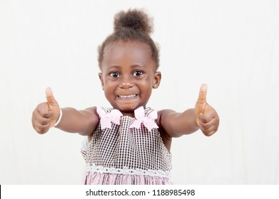 Young child at home approving make a positive gesture with the hand smiling and happy to succeed looking at the camera, concept gesture of the winner.