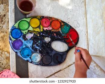 Young child kid enjoying painting creative childhood fun