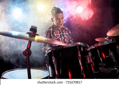 young child musician playing the drums