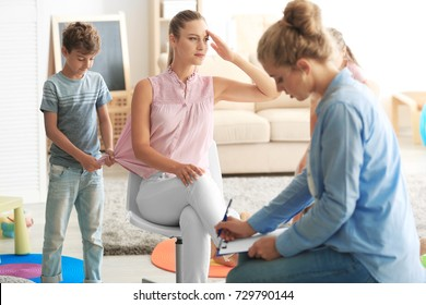 Young child psychologist working with family in office