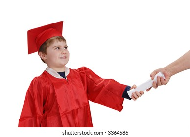 Young child, in red graduation robe and cap, smiling while receiving his diploma