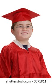 Young child, in red graduation robe and cap, smiling, isolated on white