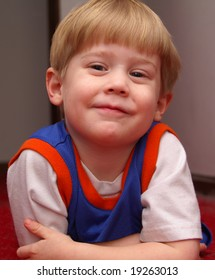 A young child smiling