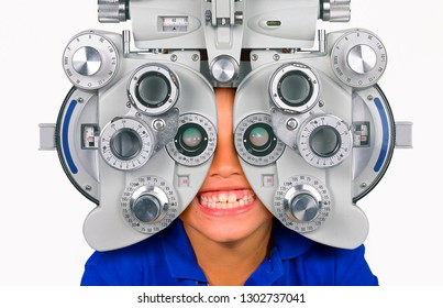 young child smiling happy at hospital looking through optometric hospital device checking eyes having sight exam in ophthalmology health care isolated on white background
