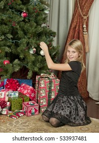 Young children by the family christmas tree