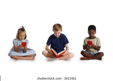 The young children of different races sitting together - two playing electronic games and the third reading a book. This image is one of a series of conceptual images isolated on white backgrounds.