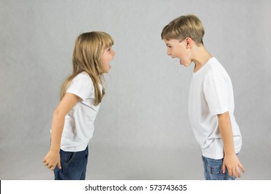 Young children fighting and shouting at each other